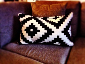We have funky black and white art on our wall, so these throw pillows from Ikea went really well on our sofa